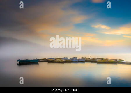 Anglers boats in dawn light at Thornton Reservoir, Leicestershire. - Stock Image