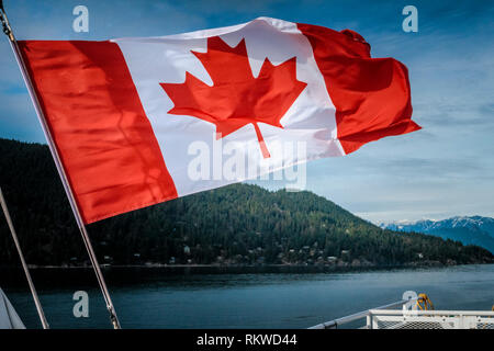 Canadian flag on the Bowen Island ferry. - Stock Image