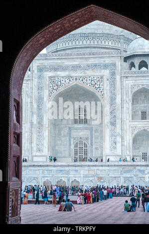 The Taj Mahal in Agra, India, viewed through an archway - Stock Image