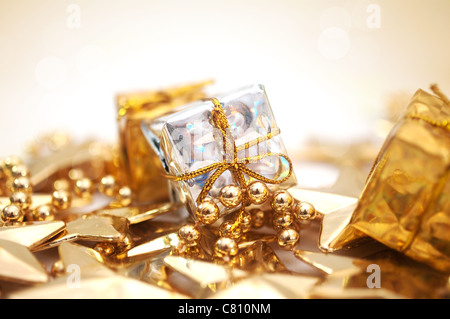 Christmas background with decorations in gold - Stock Image