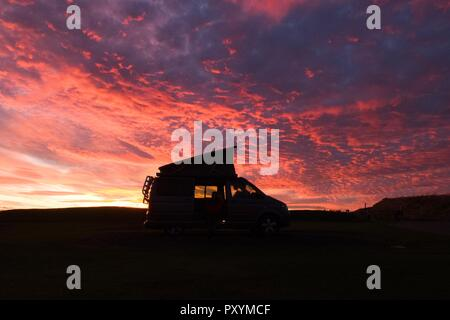 Crail, East Neuk of Fife, Scotland, UK. 24th Oct, 2014. uk weather - a Campervan beneath a dramatic sunset at the village of Crail on the Fife coast Credit: Kay Roxby/Alamy Live News - Stock Image