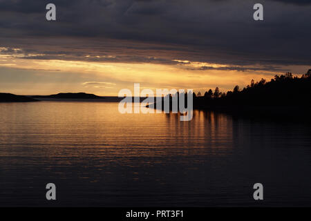 A sunset view over a sea loch in north west Scotland near Lochinver - Stock Image