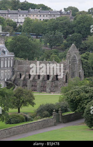A general view of Holyrood Abbey ( Ruin) and Holyrood Palace behind it in Holyrood Park Edinburgh - Stock Image