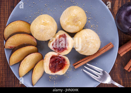Austrian traditional dumplings filled with plum - Stock Image