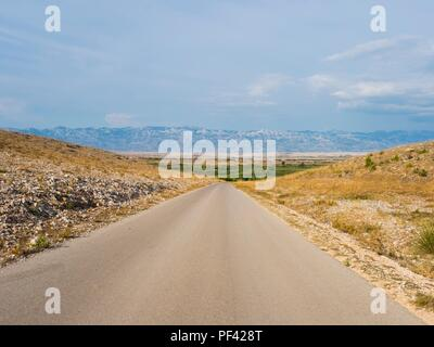 Straight piece of road near Povljana on Pag island in Croatia - Stock Image