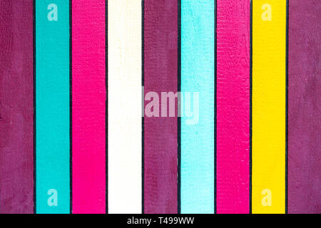 Brightly painted colourful vertical strips of wood - Stock Image