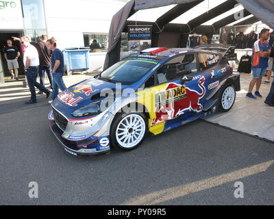 Ford Fiesta RS WRC rally car as driven by Sebastien Ogier and co-driver Julien Ingrassia shown at donnington park race circuit at the RS owners club national day 2017 fresh from a rally with battle scars front and side view - Stock Image