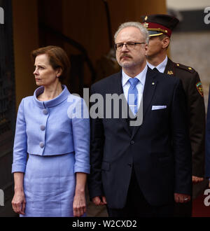RIGA, LATVIA. 8th of July 2019. Andra Levita (L), first lady of Latvia, Egils Levits (2nd from Left), newly elected President of Latvia, during Symbolic handover of the keys of the Riga Castle by President of Latvia Raimonds Vejonis to Newly Elected President of Latvia Egils Levits accompanied by First Ladies of Latvia Iveta Vejone and Andra Levite. Credit: Gints Ivuskans/Alamy Live News - Stock Image
