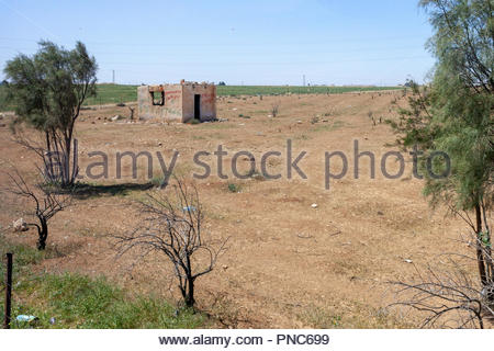 Abandoned Farmhouse in a Barren Untended Field in Jordan, near Amman in the Middle East - Stock Image