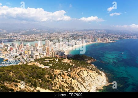Calp view from Penon de Ifach to La Fossa beach and blue mediterranean sea - Stock Image