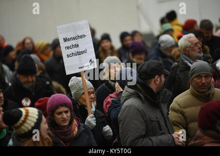 Vienna, Austria. 13th Jan, 2018. protester holding a sign demanding the protection of human rights during an anti - Stock Image