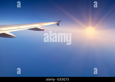 Right wing of an airplane flying over Mediterranean Sea - Stock Image