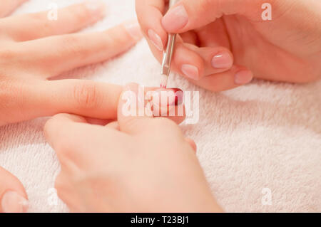 French manicure procedure in a nail salon. - Stock Image