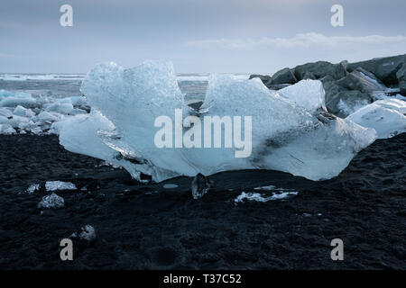 Iceberg on a beach, Diamond Beach Joekulsarlon, Iceland - Stock Image