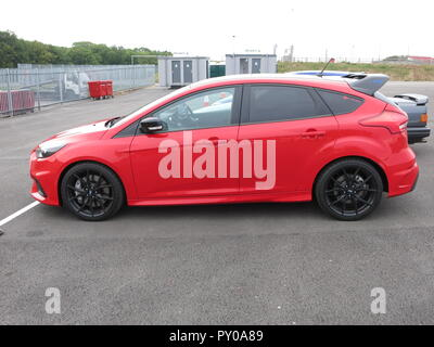 Ford Focus RS mk3 in limited edition Red on show at the RS OWNERS CLUB National day at donnington park race circuit - showing side view of car - Stock Image
