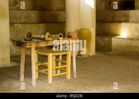 A small rough wooden table with Torah Scroll in the Synagogue at the open air museum of Nazareth Village Israel. This site provides an authentic look  - Stock Image
