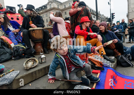 London, UK. 16 February 2019. The 16th 'Reclaim Love' free Valentine's Day street party takes place around the statue of Eros in Piccadilly Circus, with drumming, music, dancing poetry to celebrate love. The event, which was founded by poet Venus CuMara, aims to reclaim love as a manifestation of the human spirit from the sleazy commercialisation which has taken over Valentine's Day as a festival of profit. Credit: Peter Marshall/Alamy Live News - Stock Image