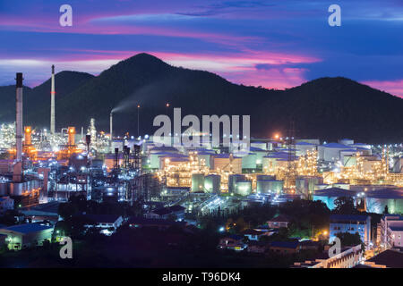 Landscape of oil refinery industry with oil storage tank in night. - Stock Image