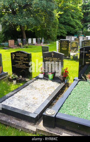 Gravestones in the graveyard of  St Peters church, Woolton, Liverpool, notably including the burial place of Bob Paisley (1919-1996) who was manager o - Stock Image