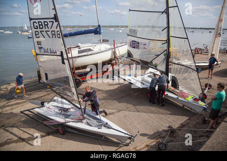Preparing to race single-handed sail boats by the Blackwater Estuary - Stock Image