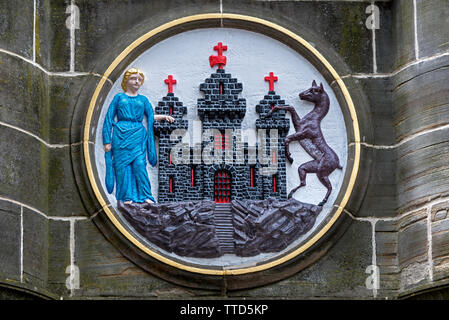 The burgh arms of Edinburgh on the Mercat Cross in Parliament Square next to St Giles Cathedral on the High Street in the Old Town of Ed - Stock Image