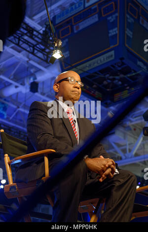 Long Island, USA. 23rd May, 2018. Reporter, sitting on media riser, tapes political news segment during Day 1 of New York State Democratic Convention, held at Hofstra University on Long Island. Credit: Ann E Parry/Alamy Live News - Stock Image