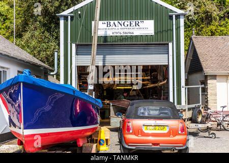 Boatbuilding, Shipwright, Salcombe, Devon, UK, England, boat builders, salcombe boatyard, boatyards, boat building, repairs, repairer, builder, boat, - Stock Image