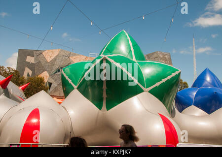 Arboria is a walk-in inflatable installation, set up in Federation Square, Melbourne, until 28 Jan 2018. At rear - Stock Image