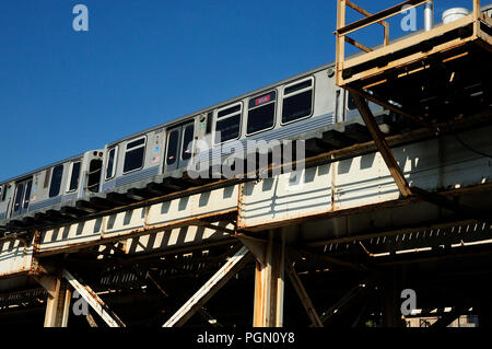 The Chicago 'L' or elevated train passing over Irving park Rd. - Stock Image
