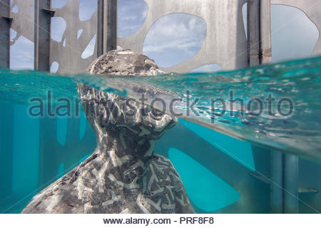 Underwater statue of the Coralarium imbedded with coral in Maldives - Stock Image