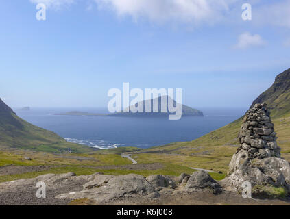 Looking south west towards the small uninhabited island of Koltur, taken from Nordradalsvegur on the main island of Faroe - Stock Image