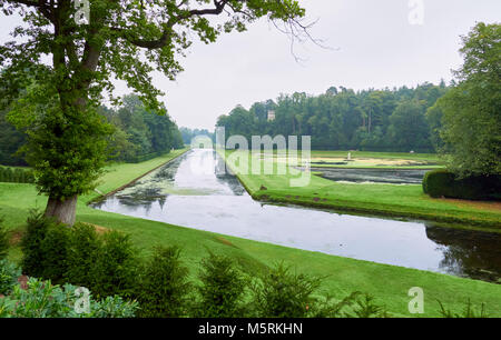 Large ponds in a formal water park garden in North Yorkshire on an overcast day in summer. - Stock Image