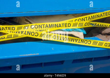 Contaminated recycling bin - Stock Image
