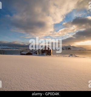 Barn in coastal winter landscape, Vestvågøy, Lofoten Islands, Norway - Stock Image