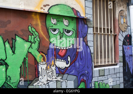 Graffiti image of a horned being on an alley wall in the city centre of Perth, Western Australia. - Stock Image