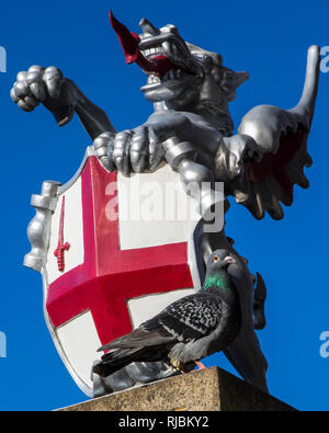 A dragon sculpture on London Bridge in London, UK.  There are various dragon statue boundary markers that mark the boundaries of the City of London. - Stock Image