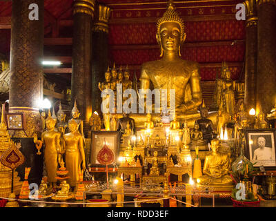 Gilded buddha in Haw Prabang one of temples of Luang Prabang Royal Palace and national museum is a set of buildings in French colonial style 1904 - Stock Image