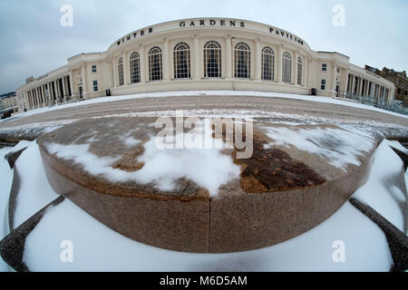 The Winter Gardens, Weston super mare. UK. 2nd March, 2018. Churned up snow along the road on the sea front after - Stock Image