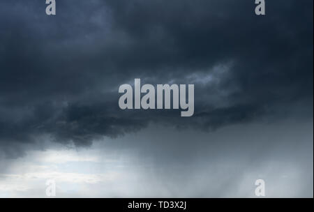 dark cloudscape with stormy clouds and rain - Stock Image