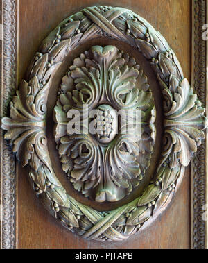 Floral engraved decorations of a royal era wooden ornate door leaf, Manial Palace of Prince Mohammed Ali, Cairo, Egypt - Stock Image