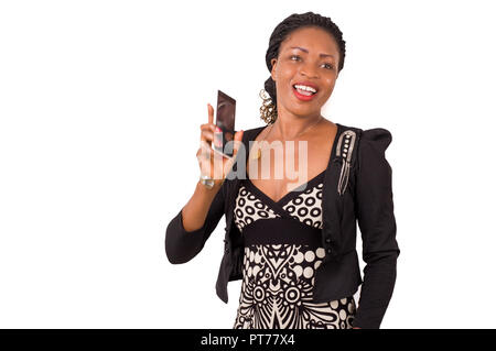Smiling young woman presents her cell phone to someone. - Stock Image