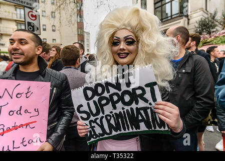 London, UK. 6th April 2019. People outside the Dorchester Hotel in Mayfair against the multi-billionaire Sultan of Brunei who has announced death by stoning as a punishment for gay sex, adultery and blasphemy demonstrating against this barbaric abuse of international law and human rights and calling for a boycott of his hotels around the world. After speeches and around an hour of noisy protest behind barriers keeping them away from the hotel, Class War took the initiative and pushed the barriers aside to protest directly in front of the hotel doors, and were quickly followed by the other prot - Stock Image