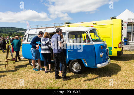 Prospective customers at the Arthington Show at a trade stall trade stall, inspecting a VW Campervan available for holiday vacation self-drive hire. - Stock Image