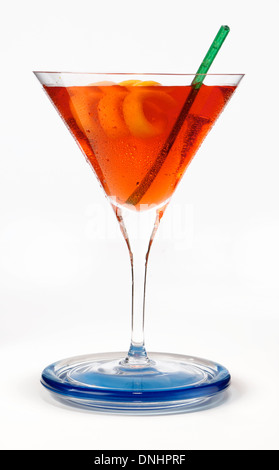 A colorful cocktail drink in a glass with a orange twist garnish. - Stock Image
