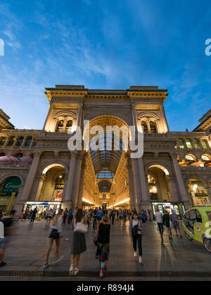 Vertical street view of Galleria Vittorio Emanuele II shopping mall at night in Milan, Italy. - Stock Image