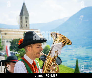 Corpus Christi cerimonial procession in Kurtatsch an der Weinstraße, Adige Valley, South Tyrol, northern Italy. tuba player from the marching band. - Stock Image