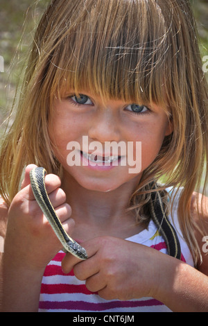 young girl garter snake smile happy wildlife reptile animal youth female - Stock Image