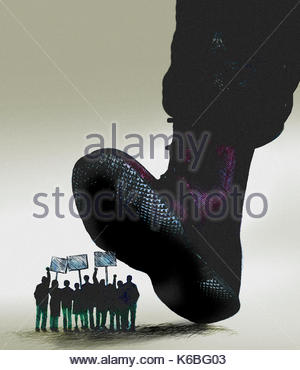 Large military boot stepping on group of protestors - Stock Image