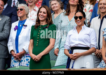 London, UK. 13th July, 2019.London, UK. 13th July, 2019. The All England Lawn Tennis and Croquet Club, Wimbledon, England, Wimbledon Tennis Tournament, Day 12; Catherine Duchess of Cambridge and Meghan Duchess of Sussex smile and laugh as Simona Halep (ROM) is interviewed Credit: Action Plus Sports Images/Alamy Live News Credit: Action Plus Sports Images/Alamy Live News - Stock Image
