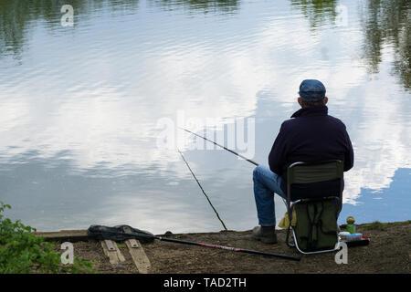 Cloud fisherman at lakeside Milton park Cambridge 2019 - Stock Image